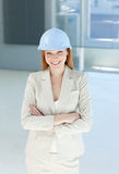 Smiling female architect with folded arms Royalty Free Stock Photography
