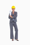 Smiling female architect with folded arms Stock Images