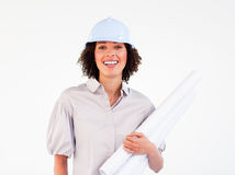 Smiling female architect holding blueprints. Smiling brunette female architect holding blueprints Stock Photo