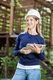 Smiling Female Architect Holding Digital Tablet At Stock Photos