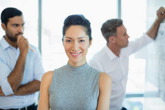 Smiling female architect standing in office Royalty Free Stock Photos
