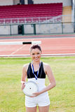 Smiling female athlete holding a disc Royalty Free Stock Photography
