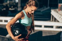 Sportswoman exercising with fitness ball Stock Photography