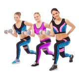 Smiling female athletes posing with dumbbells Royalty Free Stock Image