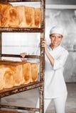 Smiling Female Baker Pushing Rack With Freshly Royalty Free Stock Photo