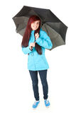 Smiling female with black umbrella, full length Royalty Free Stock Photos