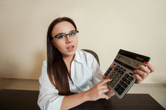 Smiling female bookkeeper has reduced balance Stock Photography