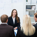 Smiling female boss or team leader Royalty Free Stock Photos