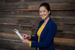 Smiling female business executive using digital tablet Royalty Free Stock Photos