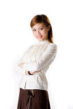 Smiling female business woman. Confident female business executive cross hand looking very approachable wearing a white blouse and dark brown skirt smiling Stock Image