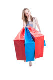 Smiling female buyer with shopping bags looking happy Stock Photos