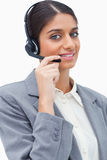 Smiling female call center agent with her headset Royalty Free Stock Images