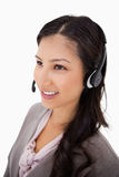 Smiling female call center agent at work Royalty Free Stock Photos