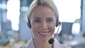 Smiling Female Call Center Employee