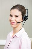 Smiling Female Call Center Employee Using Stock Photography