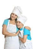 Smiling female chef with assistants Stock Photography