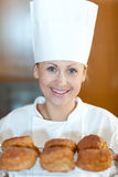 Smiling female chef baking scones Royalty Free Stock Photography