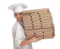 Smiling female chef with boxes of pizza Royalty Free Stock Photography