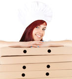 Smiling female chef with boxes of pizza Royalty Free Stock Image
