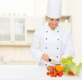 Smiling female chef chopping vegetables Royalty Free Stock Photo