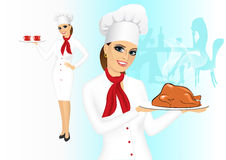 Smiling female chef with christmas roasted turkey Royalty Free Stock Image