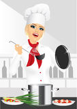 Smiling female chef, cook or baker cooking Royalty Free Stock Photo