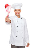 Smiling female chef with cooking equipment Royalty Free Stock Images