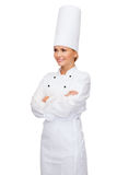 Smiling female chef with crossed arms Royalty Free Stock Images