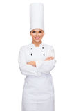 Smiling female chef with crossed arms Royalty Free Stock Image