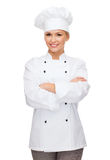 Smiling female chef with crossed arms Stock Photography