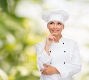 Smiling female chef dreaming Royalty Free Stock Photo