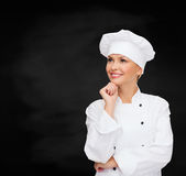 Smiling female chef dreaming Stock Photos