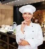 Smiling female chef dreaming Stock Photo