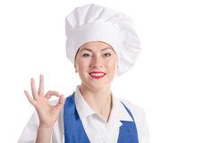 Smiling female chef isolated on a white background Stock Photos