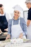 Smiling Female Chef Preparing Pasta At Kitchen Stock Photography