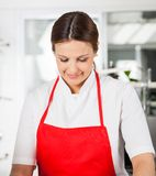 Smiling Female Chef In Red Apron At Kitchen Royalty Free Stock Photo