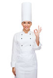 Smiling female chef showing ok hand sign Royalty Free Stock Photography