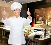 Smiling female chef showing thumbs up Stock Photography