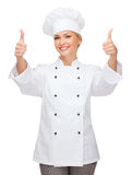 Smiling female chef showing thumbs up Stock Images