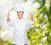 Smiling female chef showing thumbs up Royalty Free Stock Photos