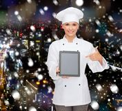 Smiling female chef with tablet pc blank screen Royalty Free Stock Image