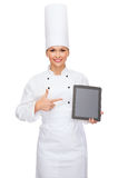 Smiling female chef with tablet pc blank screen Stock Images