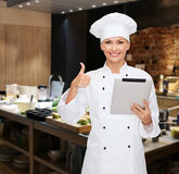 Smiling female chef with tablet pc computer Stock Photo