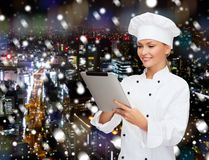 Smiling female chef with tablet pc computer Royalty Free Stock Photos