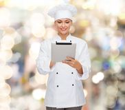 Smiling female chef with tablet pc computer Stock Photos