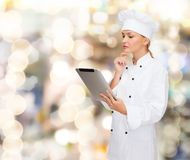 Smiling female chef with tablet pc computer Royalty Free Stock Images