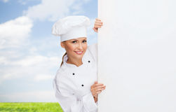 Smiling female chef with white blank board Stock Photography