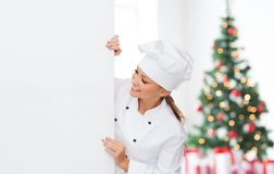 Smiling female chef with white blank board Stock Image