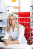 Smiling Female Chemist at Counter Royalty Free Stock Photo
