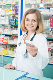 Smiling female chemist selling drugs Royalty Free Stock Images